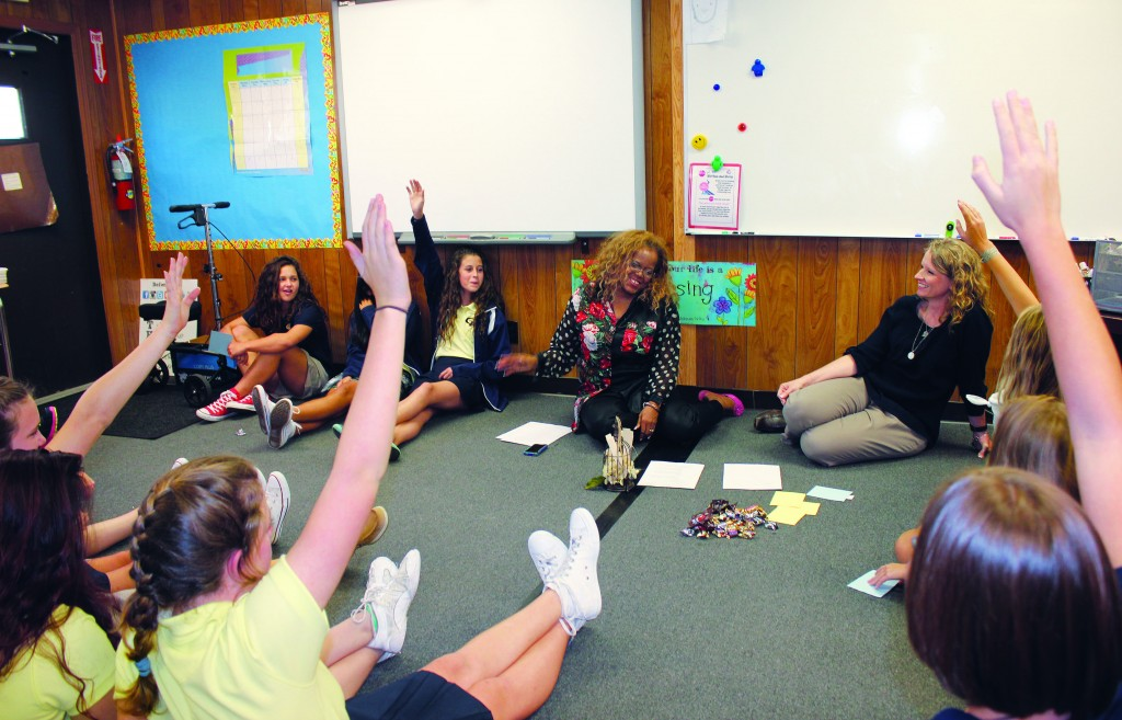 Mrs. Bullington and Mrs. A'Hart lead the 8th grade girls in a discussion about truth at September's ROG.