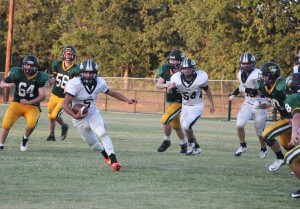 Freshman Alec Reyes sees the opening for a TD on the JV team.