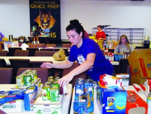 Senior Morgan Offutt helps sort food collected by the school for Mission Arlington in November.