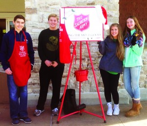 Sophomores Chandler Wilberding, Reid Reisenhoover, Junior Macy Noe, and Freshman Molly Davis ring bells for Key Club and Salvation Army early December.