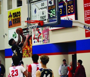 Sophomore Jordan Phillips lays the ball up to pull ahead of Lake Country in the 3rd quarter last Friday. Lions won the game 68-50.