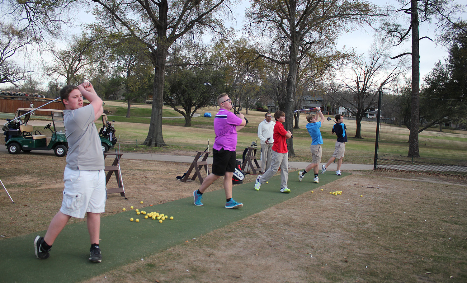 Junior Brock Potenzo, Freshman Stirling Clay, Freshman Sam Hall, Junior Alex Jordan and Senior Nathan Labenz all make the perfect swing with Coach Donavan Solis watching. The team is preparing for Regionals later this month.