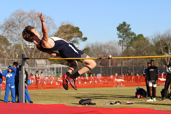 Junior Colin Toulouse high jumps at the Lena Nelson Invitational in early March.