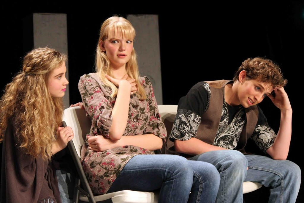 Sophomore MaKayla Lockard and Senior Maggie Bullington (worried passengers on an airplane), are upset about Sophomore Isaiah Cavanaugh's character, who is sitting next to them.