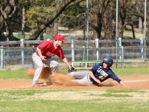 Senior Nick Thurston slides into third and is safe against Newman Academy.