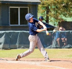 Sophomore Garrett Vardeman hits a run against Newman Academy,