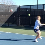 Senior Macy Noe warms up before the match against Fort Worth Christian February 22nd.