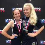 Senior Ellie Parker and Sophomore Claire Bullington stand with their bronze State TAPPS 4A medals as they are honored for their victory at the State Tennis Tournament in Waco April 10th.