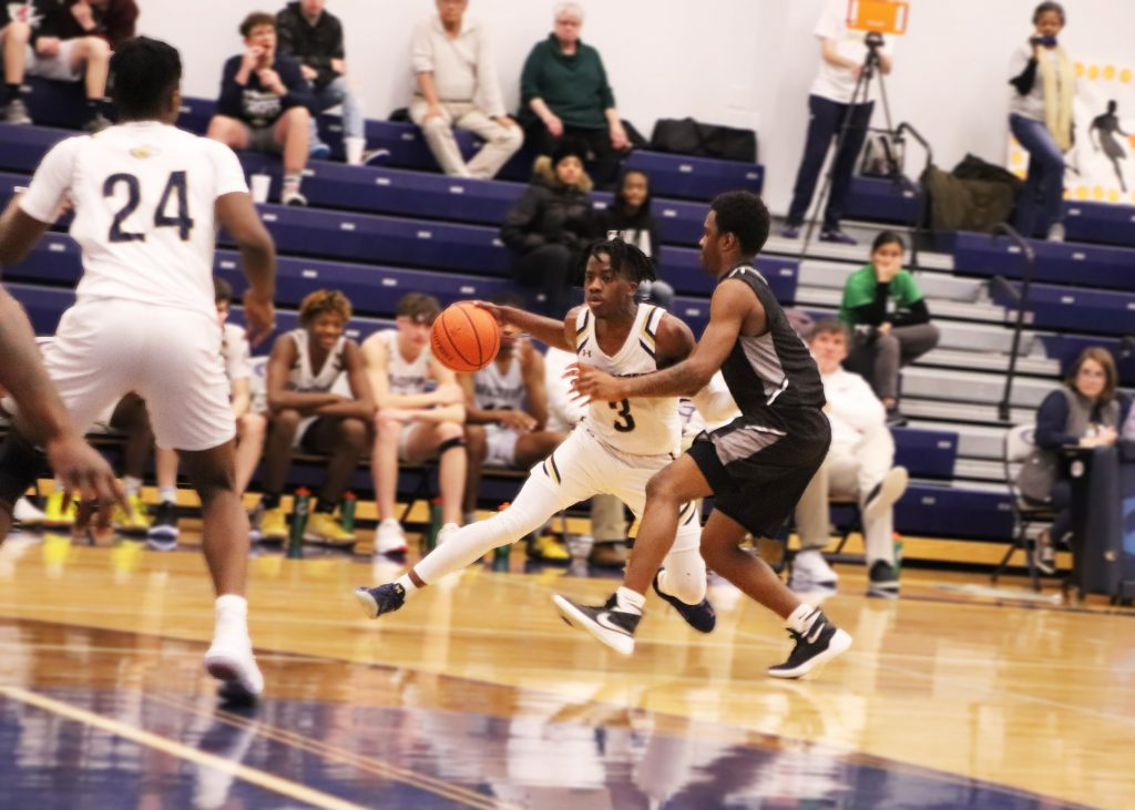 Brandon Lawrence dribbles the ball at the top of the key looking to create a play for the Lions.